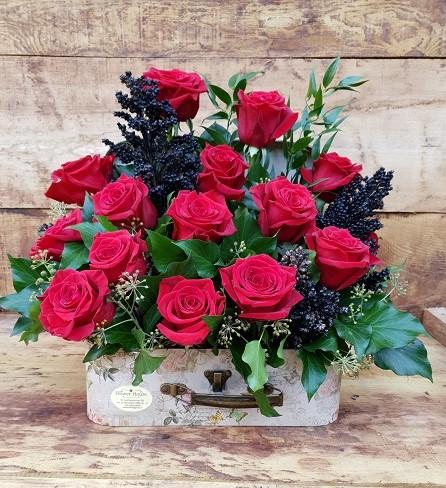 Geamantan cu trandafiri